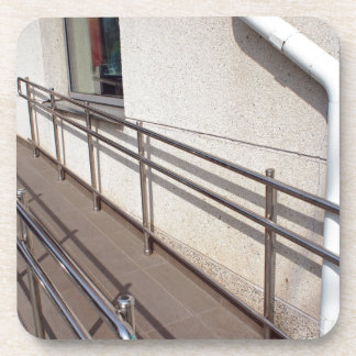 Ramp for physically challenged at the entrance beverage coaster