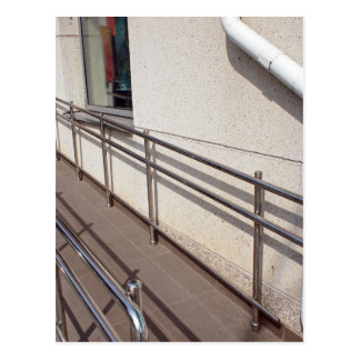 Ramp for physically challenged at the entrance postcard