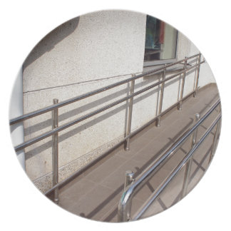 Ramp for physically challenged with metal railing dinner plate