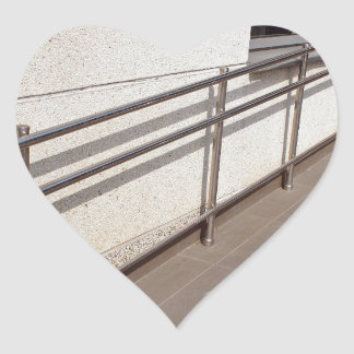 Ramp for physically challenged with metal railing heart sticker