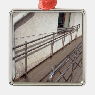 Ramp for physically challenged with metal railing metal ornament