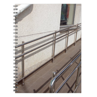 Ramp for physically challenged with metal railing notebook