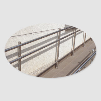 Ramp for physically challenged with metal railing oval sticker