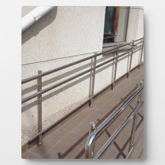 Ramp for physically challenged with metal railing plaque