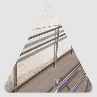 Ramp for physically challenged with metal railing triangle sticker