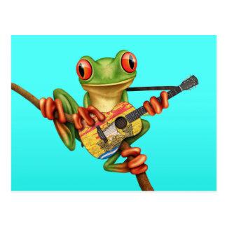 Rana arbórea que juega el azul de la guitarra de tarjetas postales