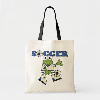 Rana con las camisetas y los regalos del balón de  bolsas