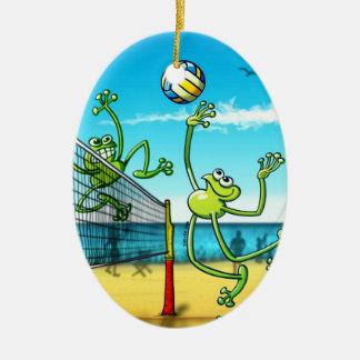 Rana del voleibol adorno navideño ovalado de cerámica