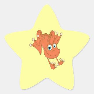 rana feliz linda del naranja de la lupulización pegatina en forma de estrella