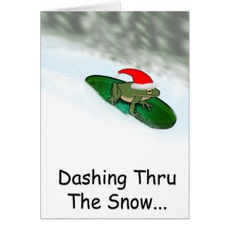 Rana que estralla a través de la nieve en un cojín tarjeta de felicitación
