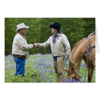 Ranchers shaking hands across the fencing in card