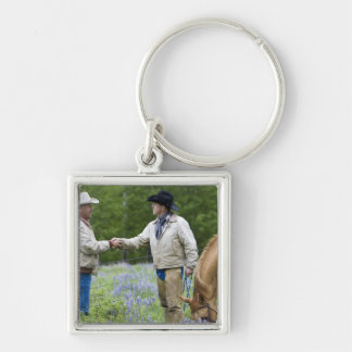 Ranchers shaking hands across the fencing in Silver-Colored square keychain
