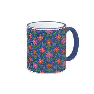 Rangoli bonito florece la taza azul del campanero