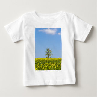Rapeseed field with apple tree and blue sky baby T-Shirt