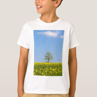 Rapeseed field with apple tree and blue sky T-Shirt