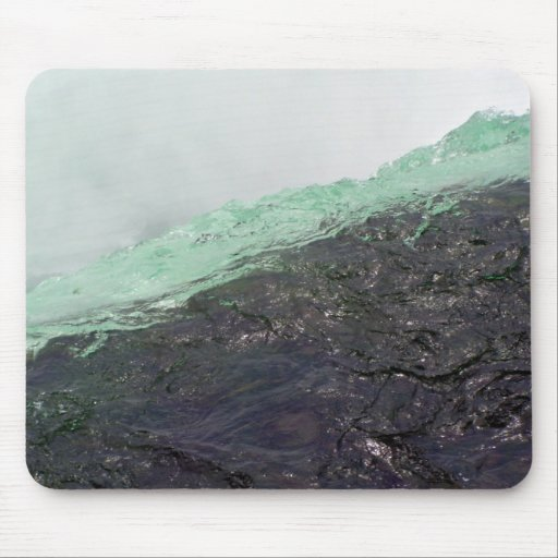 Rapid water flowing over mountain region mouse pad