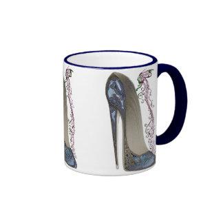 Rapsodia en arte azul de la música del estilete y taza de dos colores