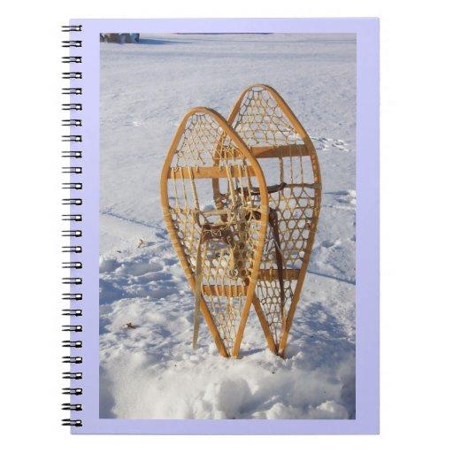 Raquetas en el cuaderno de la nieve