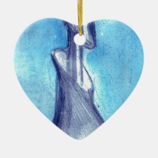 Rasgado por el cielo azul adorno navideño de cerámica en forma de corazón