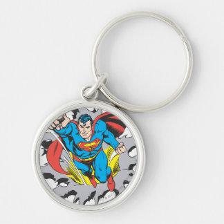 Rasgones del superhombre a través llavero personalizado