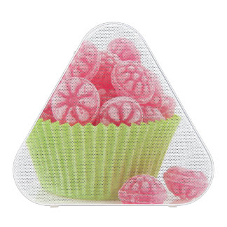 Raspberry tasty candy sweets in green cup cake speaker