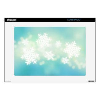 "Raster illustration of glowing snowflakes 15"" laptop skins"