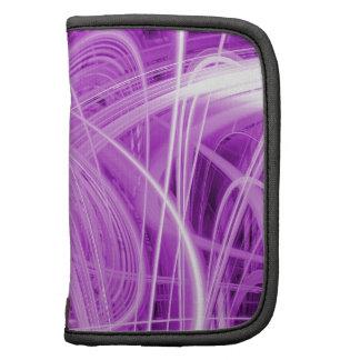 Rastros abstractos de la luz en un fondo púrpura planificador