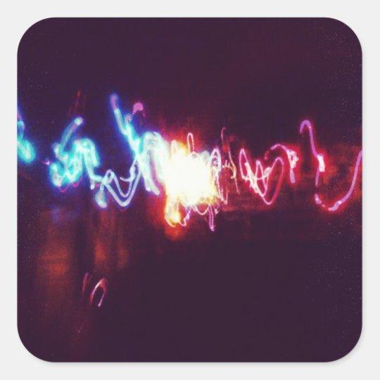 Rastros brillantes de la luz pegatina cuadrada