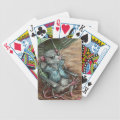 Rat on beach playing cards