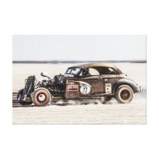Rat Rod racing down the saltpan Canvas Print