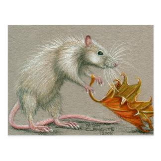 Rata con la postal de la caída de la hoja