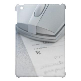 Ratón del ordenador en la prescripción escrita