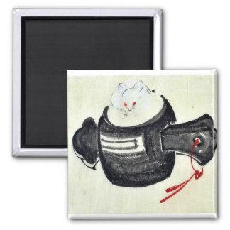 Ratón que se sienta en un mazo con la cinta roja imán de nevera