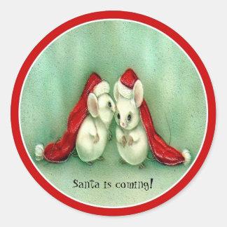 Ratones del navidad con el pegatina rojo de los