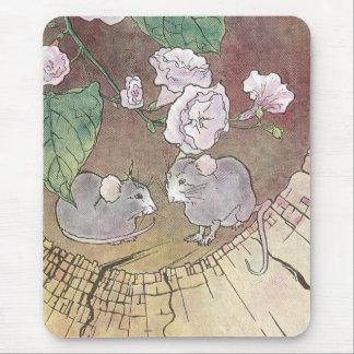 Ratones en registro con los rosas alfombrilla de ratones