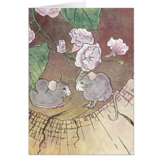 Ratones en registro con los rosas tarjeton