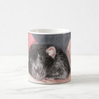 Rattie besa la taza