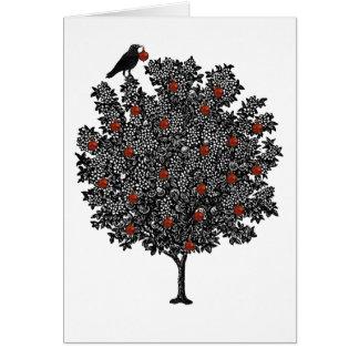 Raven decorates Christmas tree Card