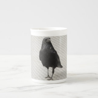raven on metall tea cup