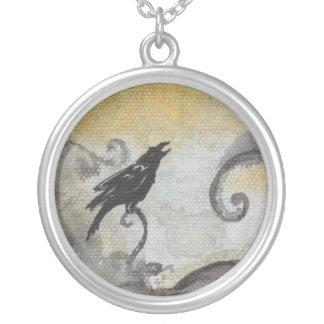 Raven on smokey orange abstract art bird necklace