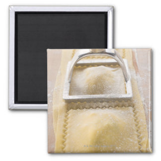 Ravioli with pastry cutter, close up magnet
