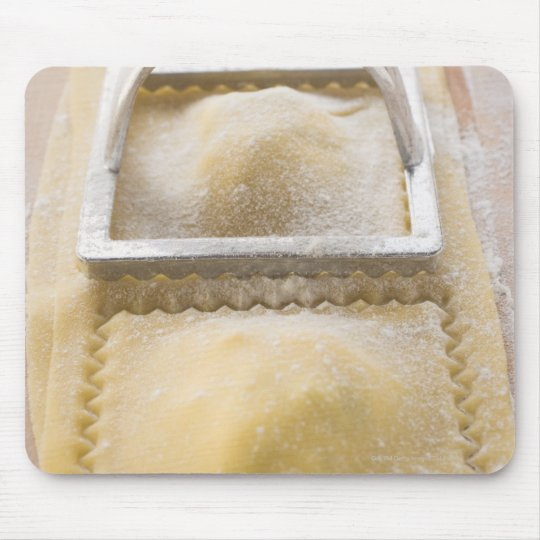 Ravioli with pastry cutter, close up mouse pad