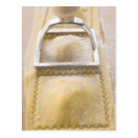 Ravioli with pastry cutter, close up postcard