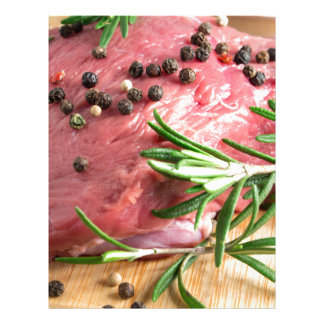 Raw beef with herbs and spices at the kitchen letterhead