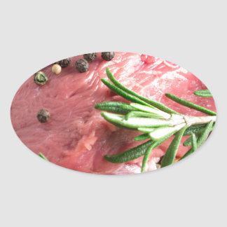 Raw beef with herbs and spices at the kitchen oval sticker