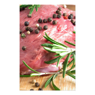 Raw beef with herbs and spices at the kitchen stationery