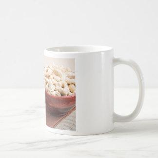 Raw cashew nuts for vegetarian food closeup coffee mug