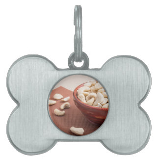 Raw cashew nuts for vegetarian food closeup pet name tag