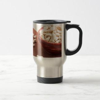 Raw cashew nuts for vegetarian food closeup travel mug