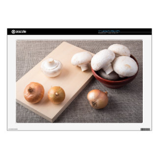 """Raw champignon mushrooms and onions on the table 17"""" laptop skins"""